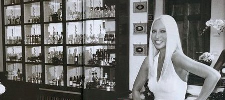Donatella with her perfume cabinet