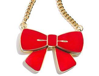 Estee Lauder bow pendant