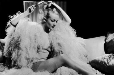 Carole Lombard combs her hair