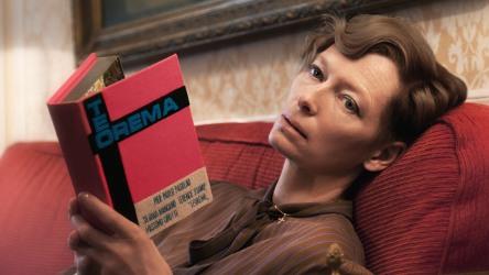 Tilda Swinton with a book